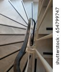 Small photo of Classic winder curve stairs. Top vertical view.