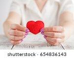 hands holding a soft heart shape   Shutterstock . vector #654836143