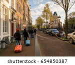 a group of tourists in... | Shutterstock . vector #654850387