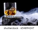 glass of whiskey and ice... | Shutterstock . vector #654894247