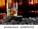 glass of whiskey and ice... | Shutterstock . vector #654894253