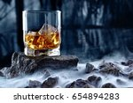 glass of whiskey and ice... | Shutterstock . vector #654894283
