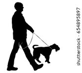 silhouette of man and dog on a... | Shutterstock . vector #654895897