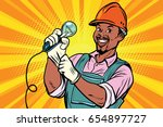 construction worker with  light ... | Shutterstock .eps vector #654897727