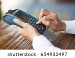 male hands entering pin code on ... | Shutterstock . vector #654932497