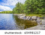 curved shoreline of a northern... | Shutterstock . vector #654981217