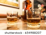 close up two glasses of whiskey ... | Shutterstock . vector #654988207