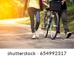young couple walking  together... | Shutterstock . vector #654992317