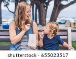 mom and son eat fried sweet... | Shutterstock . vector #655023517