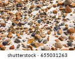 close up of smooth round pebble ... | Shutterstock . vector #655031263