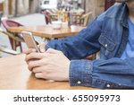 with the mobile phone in the... | Shutterstock . vector #655095973