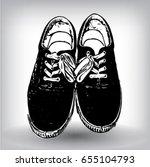 black canvas sneakers hand... | Shutterstock .eps vector #655104793