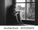 sad child  boy  sitting on a... | Shutterstock . vector #655105693