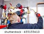 plumber assembles the boiler... | Shutterstock . vector #655155613