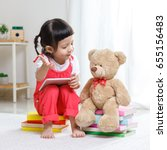 little asian girl sitting on a... | Shutterstock . vector #655156483