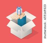 hand from box holding gift.... | Shutterstock .eps vector #655169323