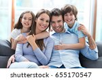 happy family at home  | Shutterstock . vector #655170547
