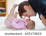 happy proud young father having ... | Shutterstock . vector #655173823