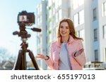 female blogger recording video... | Shutterstock . vector #655197013