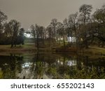Small photo of Warsaw, Poland - January 24, 2016: The Belvedere Palace, the Temple of Sibylla and their nightly reflections in the Belvedere Pond