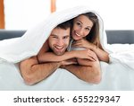 couple under bed covers  | Shutterstock . vector #655229347