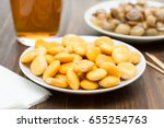 salted lupins on white plate... | Shutterstock . vector #655254763