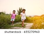 two asian little girls having... | Shutterstock . vector #655270963
