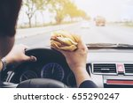 man driving car while eating... | Shutterstock . vector #655290247