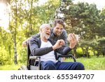 hipster son and father in... | Shutterstock . vector #655349707