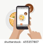 hand holding smartphone and... | Shutterstock .eps vector #655357807