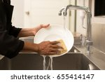 woman washing the dishes in... | Shutterstock . vector #655414147