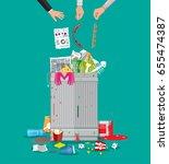 steel garbage bin full of trash.... | Shutterstock .eps vector #655474387