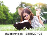 young woman reading a book in... | Shutterstock . vector #655527403