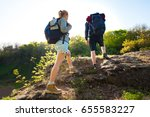 couple backpackers hiking in... | Shutterstock . vector #655583227