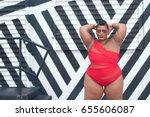 Plus Size Model In A Red Bikin...