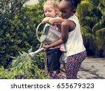 children are in the garden... | Shutterstock . vector #655679323
