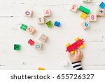 top view on child's hand... | Shutterstock . vector #655726327