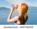 Small photo of Young girl asian athlete drinking protein shake nutrition and listen music after exercise running workout outdoor at beach seaside in summer for muscle building and slim fit body nice strong perfect.