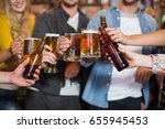 close up of friends toasting... | Shutterstock . vector #655945453