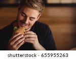 Happy Man Eating Burger In...