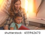 father mother child reading and ... | Shutterstock . vector #655962673