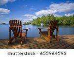 Two Muskoka Chairs Sitting On ...