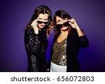 attractive young women lowering ... | Shutterstock . vector #656072803