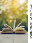 open book on the wooden table  | Shutterstock . vector #656074363