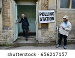 Small photo of Chippenham, UK - June 8, 2017: Voters leave a polling station at a village hall. Polling stations have opened across the nation as voters decide UK's government in a general election.