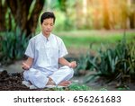 man is meditating in the park... | Shutterstock . vector #656261683
