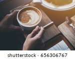 hot latte coffee cup on table | Shutterstock . vector #656306767
