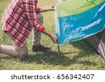asian man preparing tent for... | Shutterstock . vector #656342407