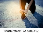 young girl asian knelt down to... | Shutterstock . vector #656388517