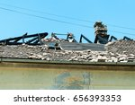 damaged roof of the abandoned... | Shutterstock . vector #656393353
